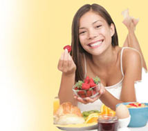 Young lady eating a reasonably healthy diet, which for the most part would help keep hemroids away.
